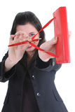 Businesswoman with notepad aiming Royalty Free Stock Photography
