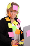 Businesswoman with notes Stock Images