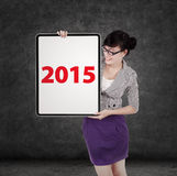 Businesswoman with number 2015 on board Royalty Free Stock Photography