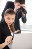 Businesswoman observing laptop with magnifying glass. Stock Photo