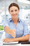 Businesswoman offering hand in greeting Royalty Free Stock Photo