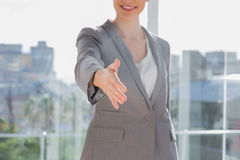 Businesswoman offering hand for handshake Stock Images