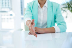 Businesswoman offering a handshake Stock Photo