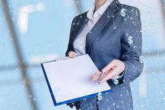 Businesswoman offers to conclude a contract online. Businesswoman offers to conclude a contract online on blurred background royalty free stock photo