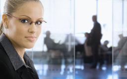 Businesswoman in office. Closeup portrait of young businesswoman in office lobby royalty free stock photo