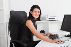 Businesswoman in office Stock Photo