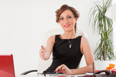 Businesswoman at the office. Stock Photos