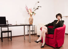 Businesswoman in a office Royalty Free Stock Images