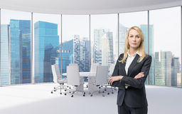 Businesswoman in office. Beautiful businesswoman standing in big office Stock Image