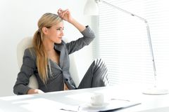Businesswoman in the office. Break time Royalty Free Stock Images