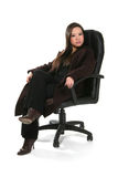 Businesswoman in office chair Royalty Free Stock Image