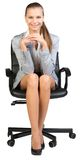 Businesswoman on office chair, with hands clasped Royalty Free Stock Photos