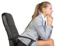 Businesswoman on office chair, with head reclined Stock Image