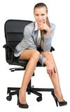 Businesswoman on office chair with head reclined Stock Photo