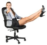 Businesswoman on office chair with her feet up Royalty Free Stock Images