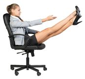 Businesswoman on office chair with her feet up Stock Photo