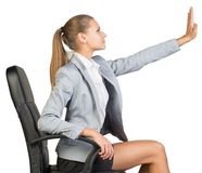 Businesswoman on office chair, with her hand Stock Photo