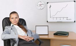 Businesswoman in office chair, with her hands Royalty Free Stock Image