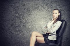 Businesswoman in office chair, looking at camera Royalty Free Stock Image