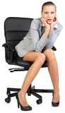 Businesswoman on office chair, looking surprised Stock Image