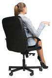 Businesswoman on office chair, making gesture as Royalty Free Stock Images