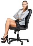 Businesswoman in office chair with straight back Royalty Free Stock Photos