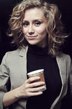 Businesswoman in Office with Coffee. Blond Young Businesswoman in Office with Coffee royalty free stock photography
