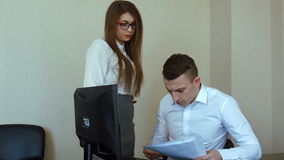 Businesswoman in office gets reprimand from her boss, stabilized shot stock footage