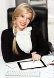 Businesswoman in the office with ipad Stock Image