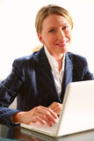 Businesswoman in office with laptop Royalty Free Stock Image