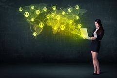 Businesswoman in office with laptop and social network world map Stock Image