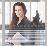 Businesswoman in office lobby Stock Image