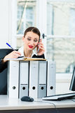 Businesswoman in office makes notes in a file Stock Photos