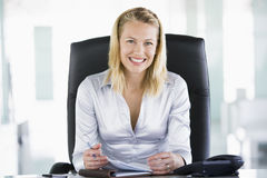 Businesswoman in office with personal organizer. Smiling Royalty Free Stock Photography