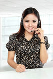 Businesswoman in office place communicate by wireless headset Stock Images