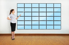 Businesswoman in office pointing Royalty Free Stock Images