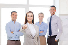 Businesswoman in office pointing finger at you Stock Photo