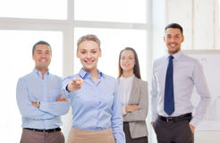 Businesswoman in office pointing finger at you Stock Photography