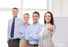 Businesswoman in office pointing finger at you Royalty Free Stock Photos