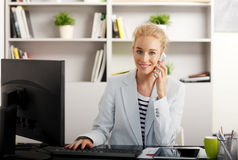 Businesswoman at office Royalty Free Stock Images
