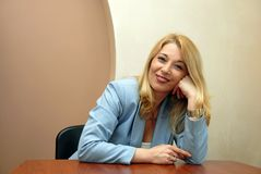 Businesswoman in office relaxed Stock Photography