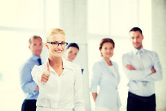 Businesswoman in office showign thumbs up Royalty Free Stock Images