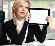Businesswoman in the office with tablet Stock Photos