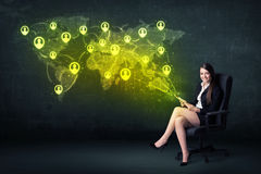 Businesswoman in office with tablet and social network world map Stock Image