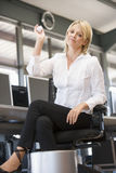 Businesswoman in office throwing garbage in bin Royalty Free Stock Photo