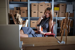 Businesswoman in office warehouse having coffee Stock Photo