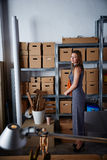 Businesswoman in office warehouse standing Royalty Free Stock Images