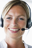 Businesswoman in office wearing headset Stock Image