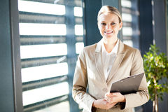 Businesswoman by office window Stock Image