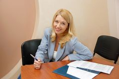 Businesswoman in office working Stock Photo